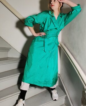 The vintage green trench coat