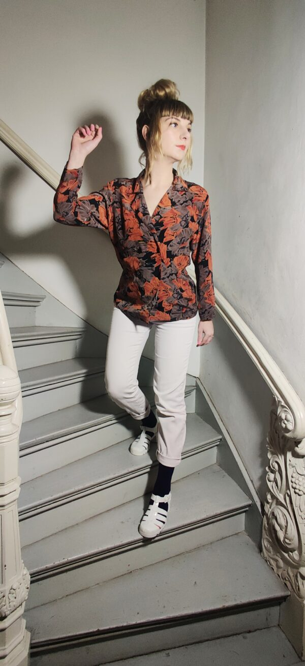 Nicks her blouse with floral print is vintage